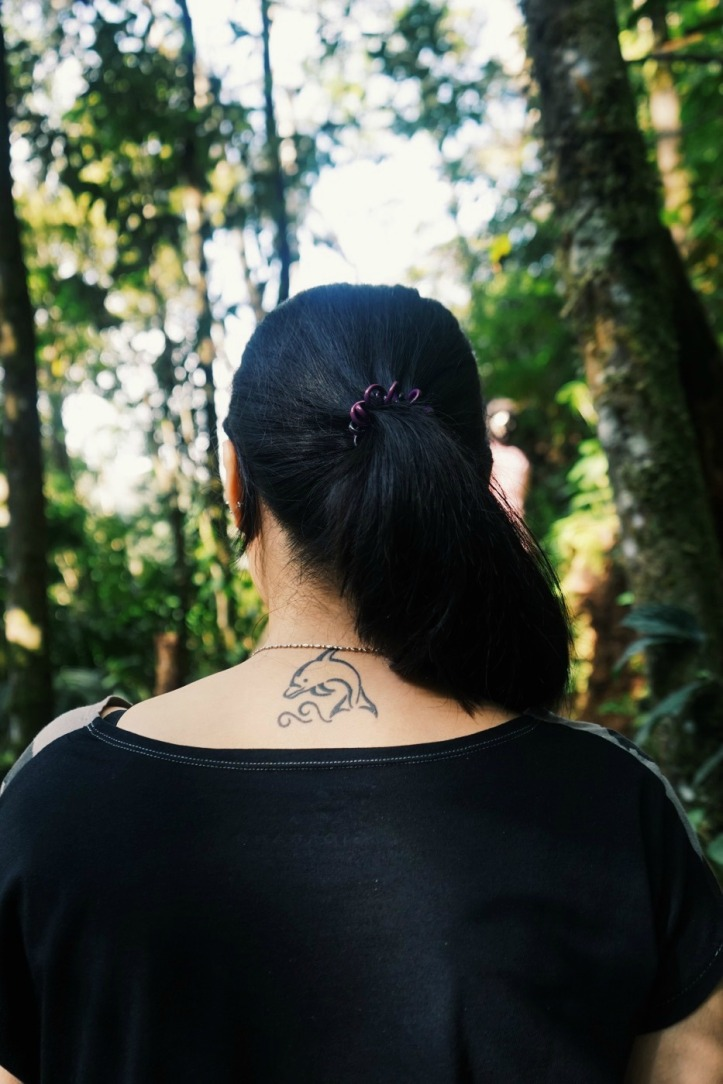 The girl with dolphin tatoo
