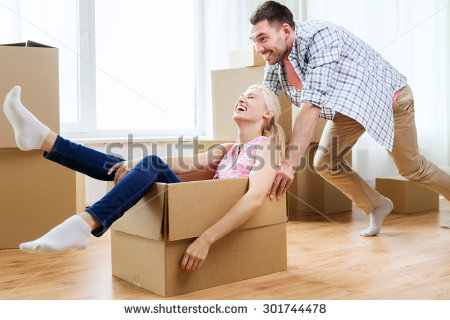 stock-photo-home-people-moving-and-real-estate-concept-happy-couple-having-fun-and-riding-in-cardboard-301744478