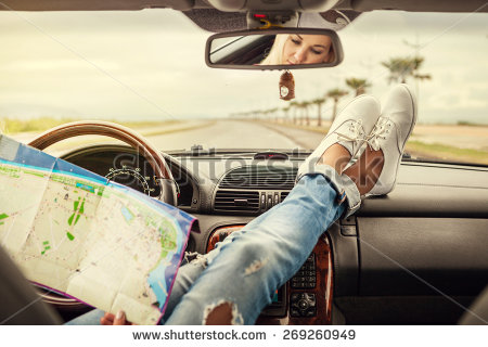 stock-photo-young-woman-alone-car-traveler-with-map-269260949