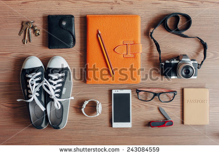 stock-photo-outfit-of-traveler-student-teenager-young-woman-or-guy-overhead-of-essentials-for-modern-young-243084559