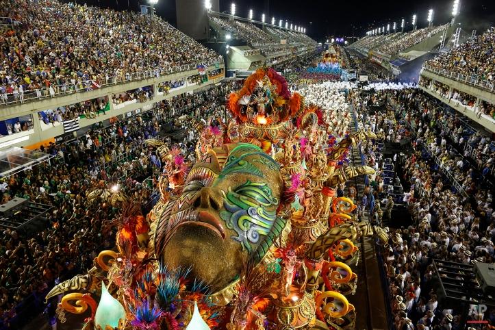 A float from the Beija Flor samba school rides through the Sambadrome during Carnival celebrations in Rio de Janeiro, Brazil, Tuesday, Feb. 17, 2015. (AP Photo/Leo Correa)