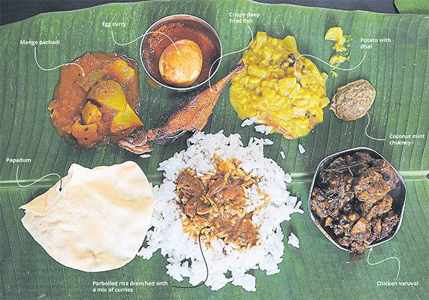 Pic Source : http://www.themalaymailonline.com/ The banana leaf rice meal is a simple one where fluffy white rice is served on a banana leaf and accompanied by a few types of vegetables, pickles, condiments like a chutney or mint sauce and papadum. — Picture by K.E. Ooi